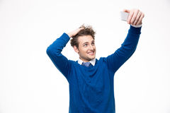 Man with curly hair making selfie photo Stock Photography