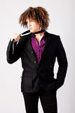 Man with curly hair in suit Stock Images