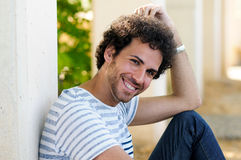 Man with curly hairstyle smiling Royalty Free Stock Images