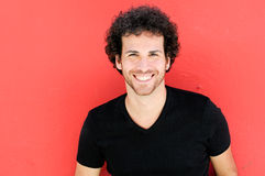 Man with curly hairstyle smiling Stock Photography