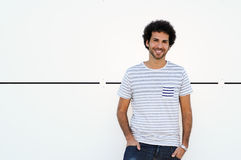 Man curly hairstyle smiling in urban background Royalty Free Stock Photo