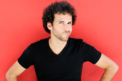 Man with curly hairstyle in urban background Stock Image