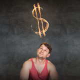 Man and currency symbol overhead. Blazing on the gray background Royalty Free Stock Photos