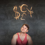 Man and currency symbols overhead. Blazing on the gray background Royalty Free Stock Images