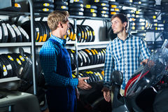 Man customer asking technician about motorcycle Royalty Free Stock Photo