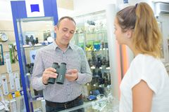 Man customer buying binoculars stock images