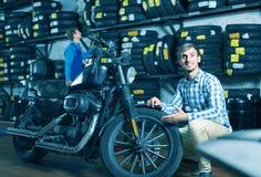 Man customer buying motorcycle Royalty Free Stock Photo