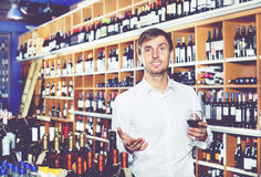 Man customer holding glass of wine Stock Photos