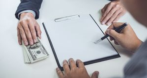 Man customer signing buying home policy document agreement, successful loan contract and salesman receive money after good deal royalty free stock photo