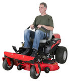 Man Cut Grass or Lawn on Zero Turn Mower Isolated. A man or male smiles as he cuts the grass on his zero turn riding lawn mower. Doing chores and home stock photos