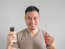 Man cut his own hair. Stock Images