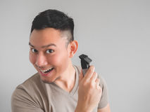 Man cut his own hair. Royalty Free Stock Images