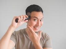Man cut his own hair. Stock Image