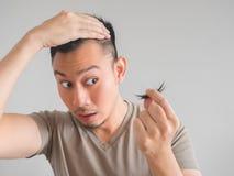 Man cut his own hair. Stock Photography