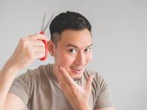 Man cut his own hair. Stock Photos