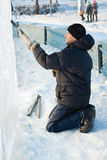 A man cut ice slab Stock Image