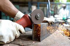 Man cut metal Stock Photo