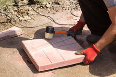 Man cut red concrete paving slabs Royalty Free Stock Photo