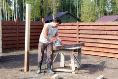 Man cut wooden beam with circular saw Royalty Free Stock Photography