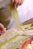 Man cuting pasta Royalty Free Stock Photography
