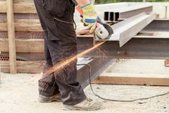 Man cuts flex steel products Royalty Free Stock Photography