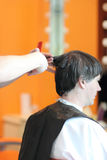 A man cuts hair in a barbershop Royalty Free Stock Photography