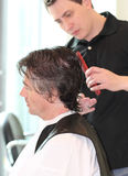 A man cuts hair in a barbershop Royalty Free Stock Image