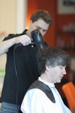 A man cuts hair in a barbershop Royalty Free Stock Images
