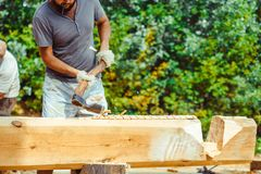 A man cuts a log Stock Photo