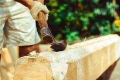 A man cuts a log Stock Photos