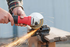 Man cuts a metal grinder. Royalty Free Stock Photography