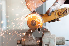 Man cuts a metal pipe. Royalty Free Stock Image