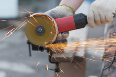 Man cuts metal. Royalty Free Stock Images