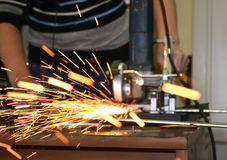 Man cuts metal and sparks Stock Image