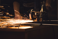 Man cuts metal and sparks Royalty Free Stock Photo