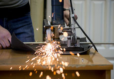 Man cuts metal and sparks Royalty Free Stock Photos