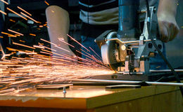 Man cuts metal and sparks Royalty Free Stock Image