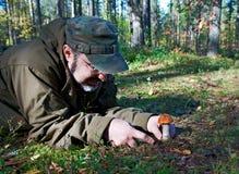 Man cuts a mushroom Stock Images