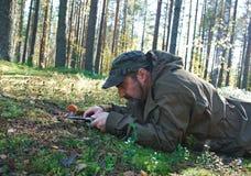 Man cuts a mushroom Stock Image