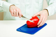 Man cuts pepper Stock Photography
