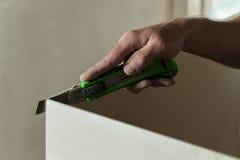 Man cuts a piece of drywall Stock Photos