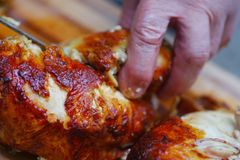 Prepping roast chicken closeup royalty free stock photography