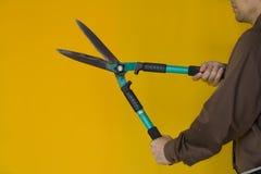 Man Cutting. Businessman cuting everything, like downsizing Royalty Free Stock Photography