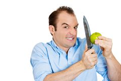 Man cutting apple Royalty Free Stock Photos