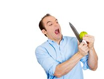 Man cutting apple Stock Photo