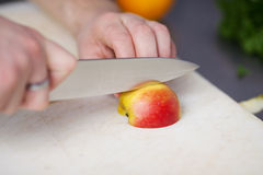 Man cutting apple Royalty Free Stock Photo