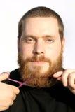 man cutting beard royalty free stock image