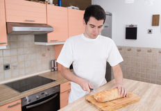 Man cutting bread royalty free stock image