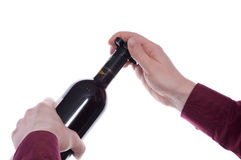 Man is cutting the capsule of a wine bottle Stock Photography