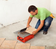 Man cutting ceramic floor tile Royalty Free Stock Photos